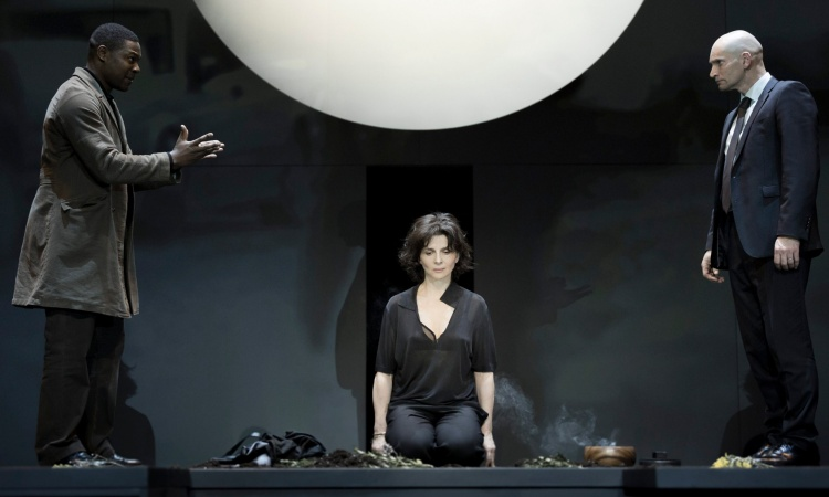 Obi Abili, Juliette Binoche and Patrick O'Kane performing in Antigone. Photograph: Jan Versweyveld/HO/EPA