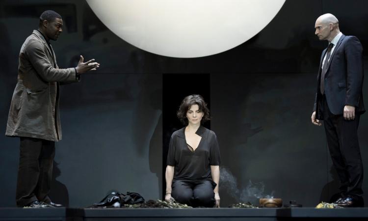 Obi Abili, Juliette Binoche and Patrick O'Kane performing in Antigone. Photograph: Jan Versweyveld/HO/EPA